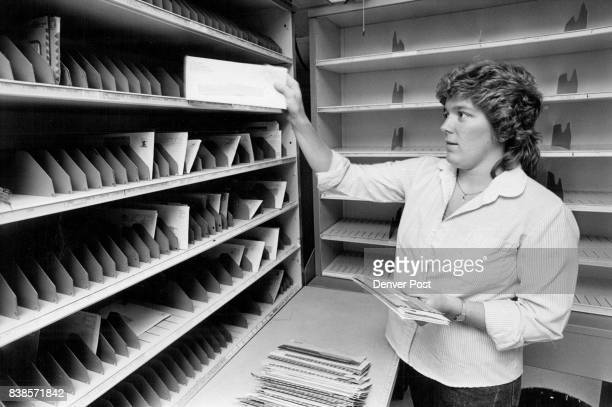 Michele Mankowski a temporary 'casual' carrier with the USPS practices 'sorting letters in preparation for her taest at the end of her training to...