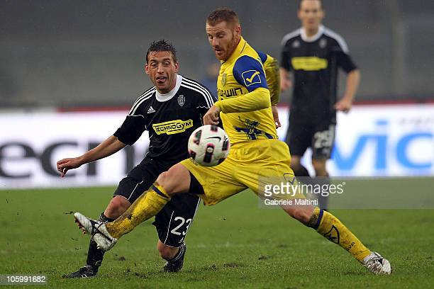 Michele Marcolini of AC Chievo Verona battles for the ball with Emiliano Giaccherini of AC Cesena during the Serie A match between AC Chievo Verona...