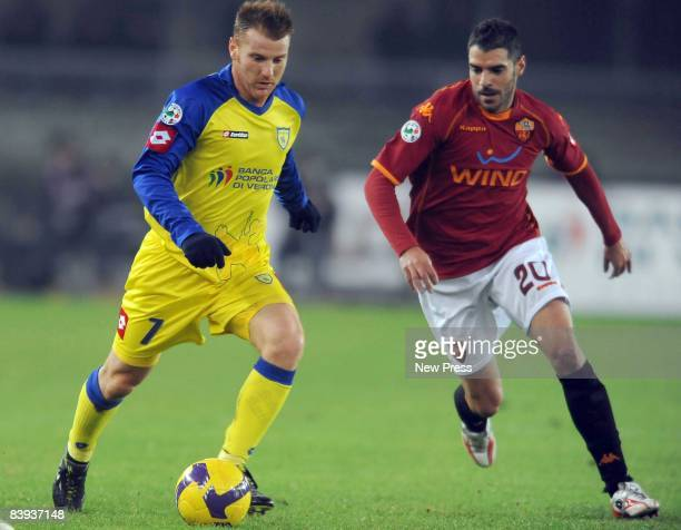 Michele Marcolini of Chievo and Simone Perrota of Roma compete for the ball during the Serie A match between Chievo and Roma at the Bentegodi Stadio...