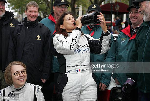 Michele Mouton of France drinks Champagne after competing in the 2008 Rally Of Otago on May 11 2008 in Dunedin New Zealand