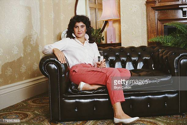 Michele Mouton the French female World Rally Championship driver for Audi AG poses for a photograph on a leather sofa at a hotel before competing in...