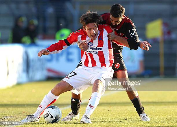 Michele Paolucci of Vicenza Calcio battles for the ball with Francesco Cosenza of Reggina Calcio during the Serie B match between Vicenza Calcio and...