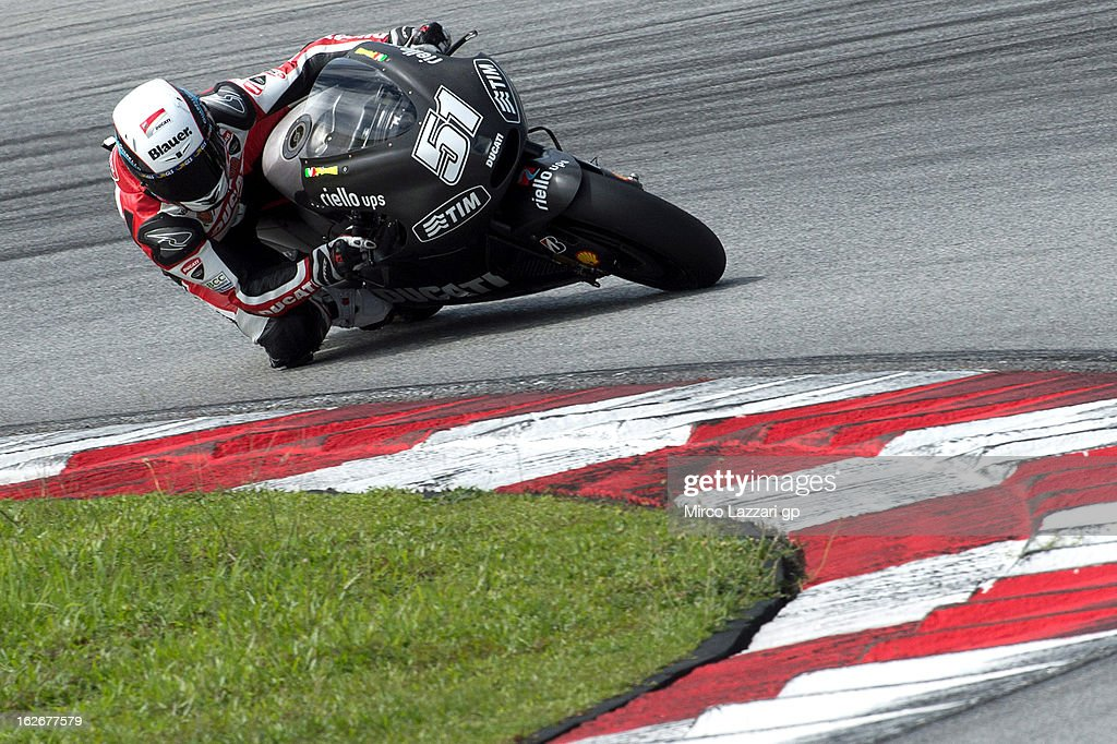 Michele Pirro of Italy and Ducati Test Team rounds the bend during day one of MotoGP Tests at Sepang Circuit on February 26, 2013 in Kuala Lumpur, Malaysia.