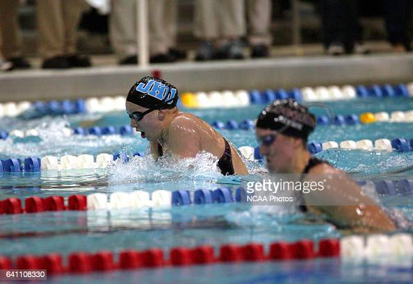 Michele Rennie of Puget Sound and Allie Foster of Johns Hopkins University race in the 200 yard during the Division 3 Women's Swimming and Diving...