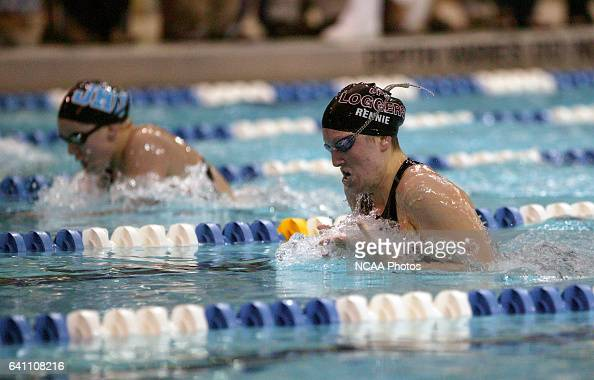 Michele Rennie of the University of Puget Sound and Allie Foster of Johns Hopkins University race toward the finish of the women's 200 yard...