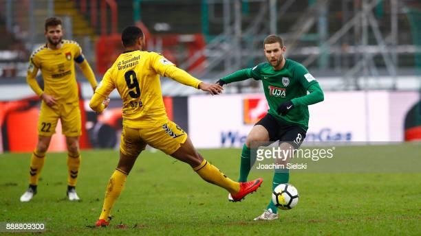 Michele Rizzi of Muenster challenges Saliou Sane of SonnenhofGrossaspach during the 3 Liga match between SC Preussen Muenster and SG...