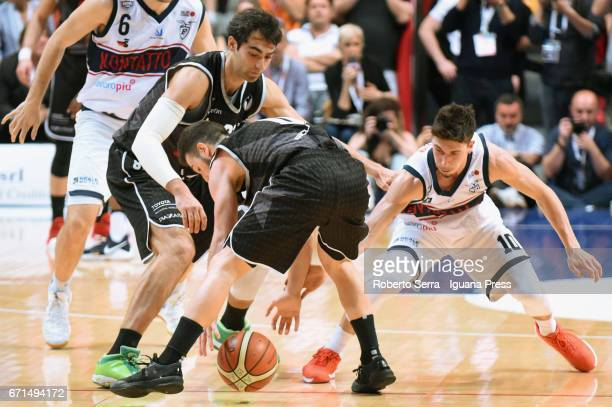 Michele Ruzzier of Kontatto competes with Davide Bruttini and Marco Spissu of Segafredo during the LegaBasket LNP of serie A2 match between Fortitudo...