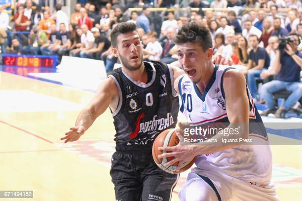 Michele Ruzzier of Kontatto competes with Marco Spissu of Segafredo during the LegaBasket LNP of serie A2 match between Fortitudo Kontatto Bologna...