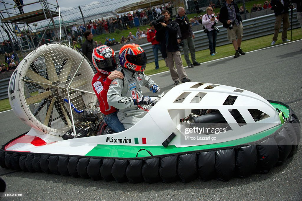 Michele Scanavino of Italy (the World and European champion) drives the hovercraft with <a gi-track='captionPersonalityLinkClicked' href=/galleries/search?phrase=Nicky+Hayden+-+Piloto+de+motociclismo&family=editorial&specificpeople=227346 ng-click='$event.stopPropagation()'>Nicky Hayden</a> of USA and Ducati Marlboro Team on track during the pre-event 'Riders from the 3 categories will drive hovercrafts' during the MotoGP of Germany at Sachsenring Circuit on July 14, 2011 in Hohenstein-Ernstthal, Germany.