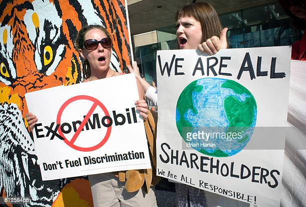 Michele Vaughan and Ashlee Whitaker both of Dallas protest outside the ExxonMobil annual shareholders meeting at the Morton H Meyerson Symphony...