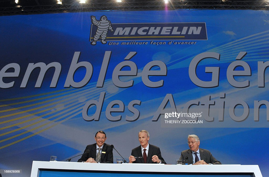 Michelin Chief Financial Officer Marc Henry group president JeanDominique Senard and Michelin General Counsel Philippe Legret attend the general...