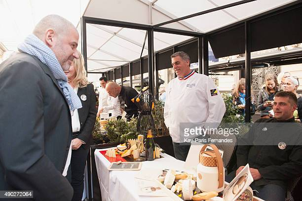 Michelin star chef Philippe Etchebest speaks to Cheese makers during the 'Fromage Fashion Week Menu' on September 27 2015 in Paris France