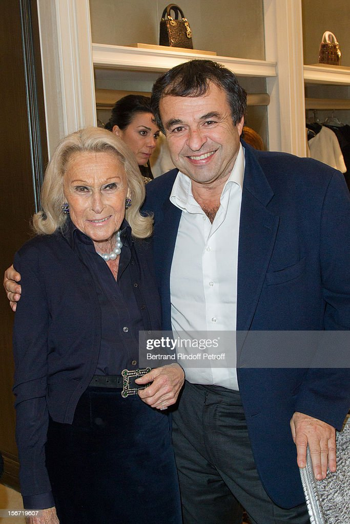 Micheline Maus (L) and Cyril Mansour attend the signing of Francis Huster's book 'And Dior Created Woman' at Dior Boutique on November 19, 2012 in Paris, France.