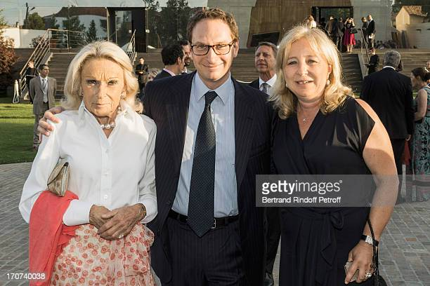 Micheline Maus her son PierreAndre Maus and Florence RogersPinault attend the dinner of Conseil des Grand Crus Classes of 1855 hosted by Chateau...