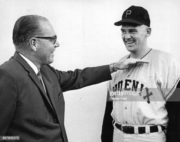Michell Dale 'The Pitch was way up here' Dale Mitchell now a Denver businessman indicates to Don Larsen Phoenix pitcher the location of the pitch on...