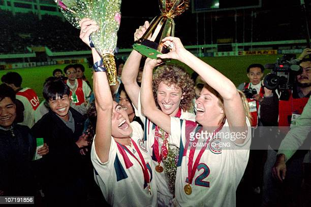 Michelle AkersStahl who scored two goals for the US to win the first FIFA World Championship for Women's Football on November 30 holds the trophy...