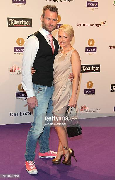 Michelle and her boyfriend Mike pose on the red carpet prior the Echo award 2014 at Messe Berlin on March 27 2014 in Berlin Germany