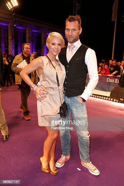 Michelle and her boyfriend Mike poses on the red carpet prior the Echo award 2014 on March 27 2014 in Berlin Germany