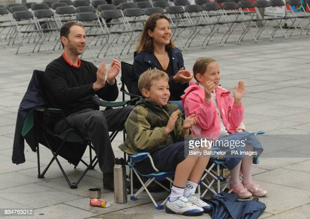 Michelle and Jeremy Peak with their children Harry and Jessica watch the big screen in Plymouth city centre as divers Tom Daley and Blake Aldridge...