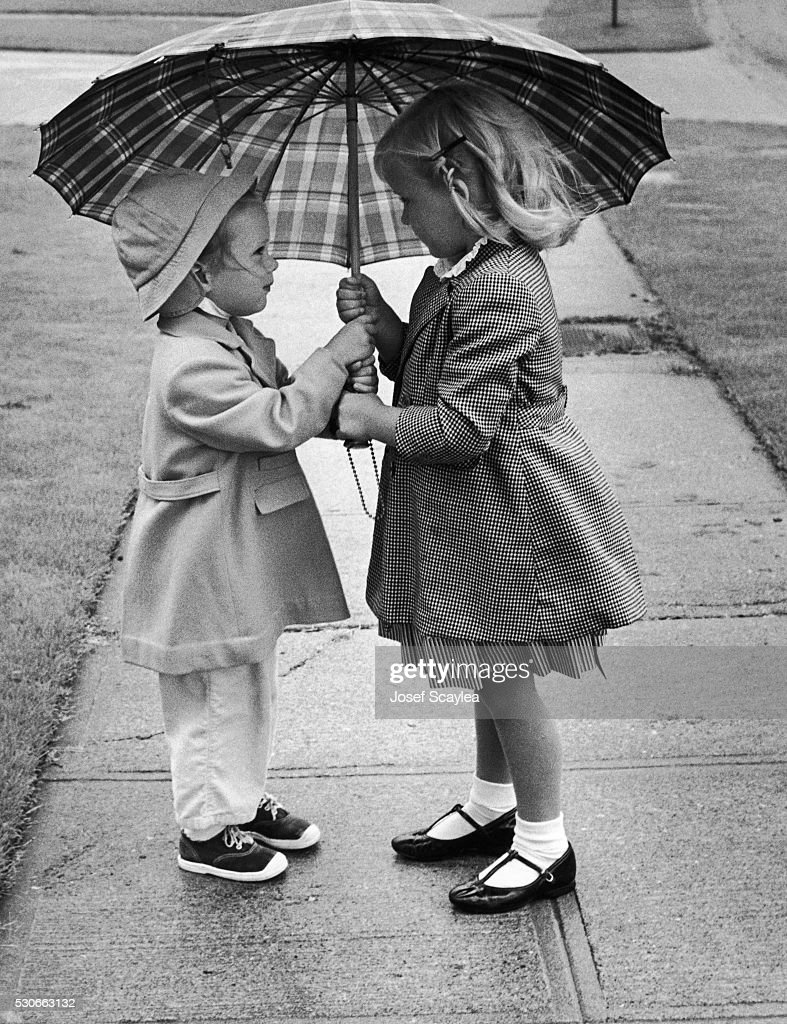 girls sharing an umbrella pictures getty images