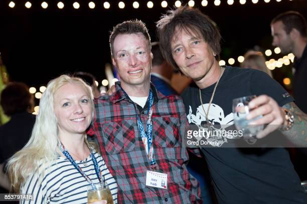 Michelle Asker Joey Paul and Guitar Player Billy Morrison pose for a photo at the UCLA Operation Mend 10 Year Anniversary at the Home of Founder Ron...
