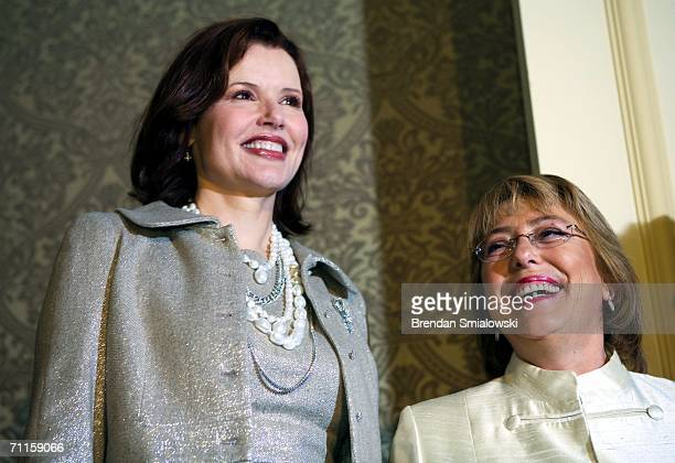 Michelle Bachelet President of Chile smiles at actress Geena Davis before a dinner to honor Bachelet Chile's first female president on May 8 2006 in...