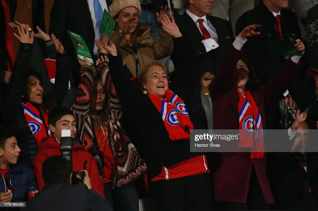 <a gi-track='captionPersonalityLinkClicked' href=/galleries/search?phrase=Michelle+Bachelet&family=editorial&specificpeople=547978 ng-click='$event.stopPropagation()'>Michelle Bachelet</a>, President of Chile waves her hands to cheer for her team during the 2015 Copa America Chile Group A match between Chile and Ecuador at Nacional Stadium on June 11, 2015 in Santiago, Chile.