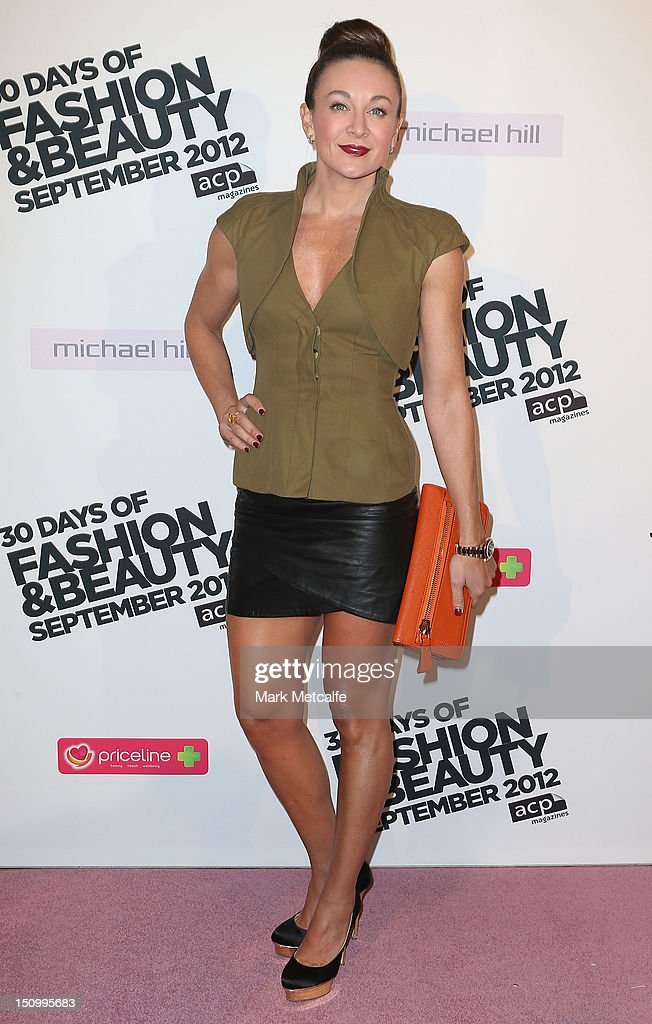 <a gi-track='captionPersonalityLinkClicked' href=/galleries/search?phrase=Michelle+Bridges&family=editorial&specificpeople=4213216 ng-click='$event.stopPropagation()'>Michelle Bridges</a> poses during the 30 Days of Fashion & Beauty Launch at Sydney Town Hall on August 30, 2012 in Sydney, Australia.