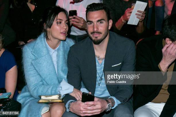 Michelle Calvo and Roberto Gimenez Gago attend the front row of The 2nd Skin Co show during Mercedes Benz Fashion Week Madrid Autumn / Winter 2017 at...