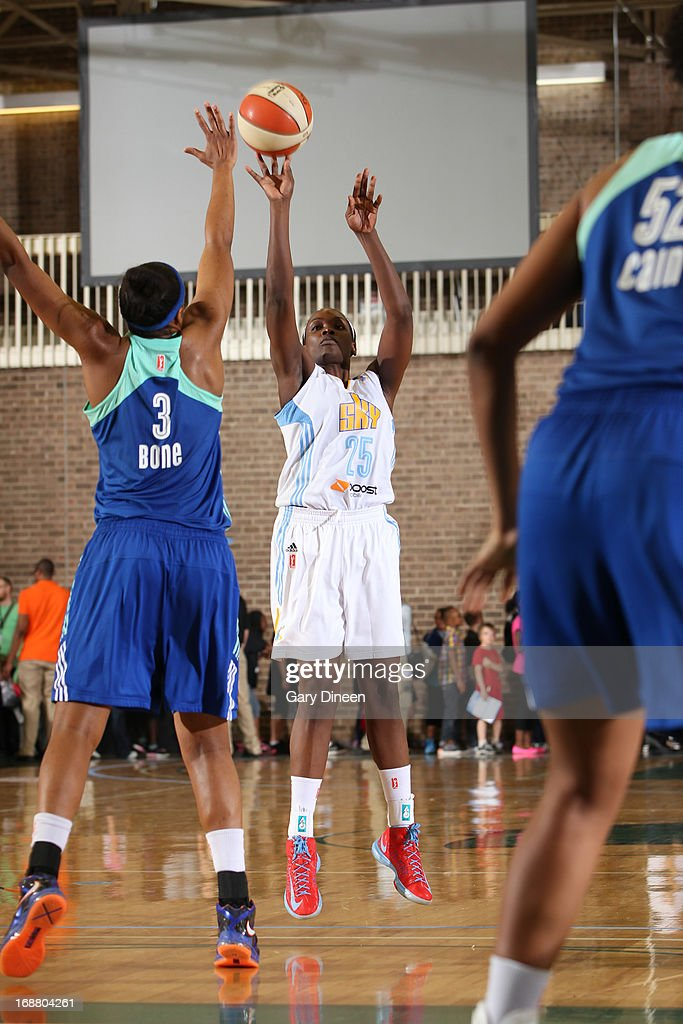 Michelle Campbell #25 of the Chicago Sky puts up a shot over Kelsey Bone #3 of the New York Liberty during the pre-season game on May 15, 2013 at the Jacoby D. Dickens Physical Education and Athletic Center on the campus of Chicago State University in Chicago, Illinois.