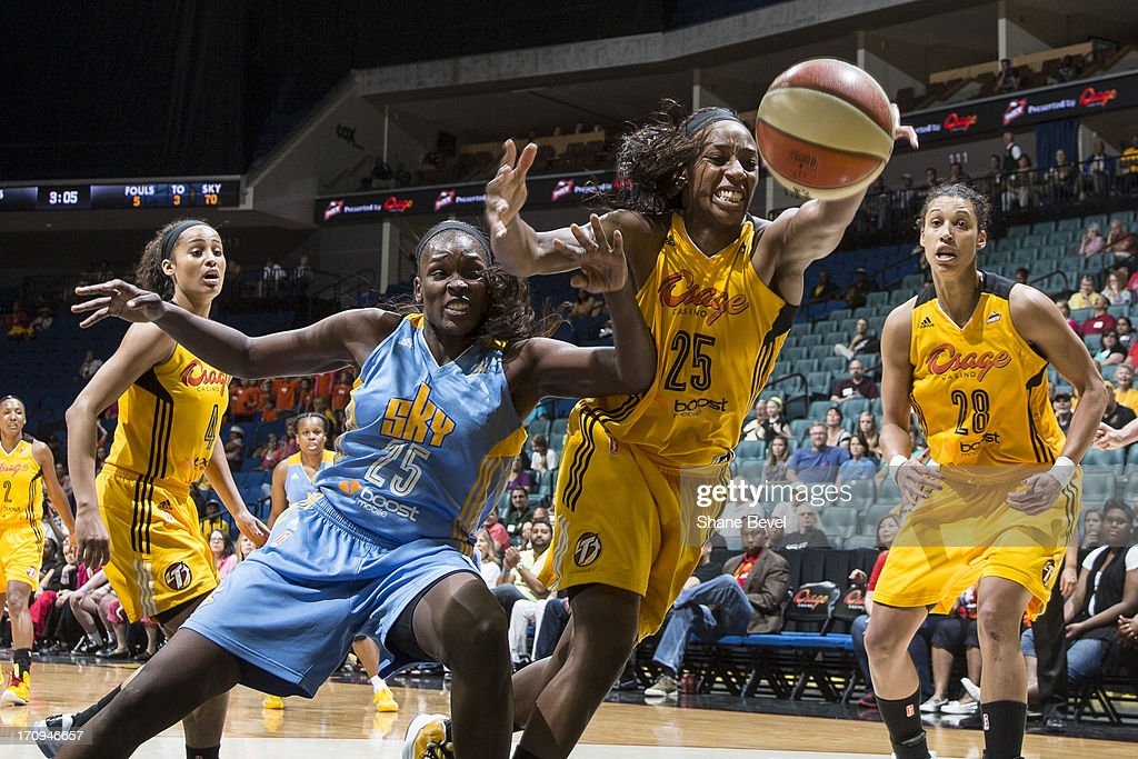 Michelle Campbell #25 of the Chicago Sky scrambles for a loose ball against Glory Johnson #25 of the Tulsa Shock during the WNBA game on June 20, 2013 at the BOK Center in Tulsa, Oklahoma.