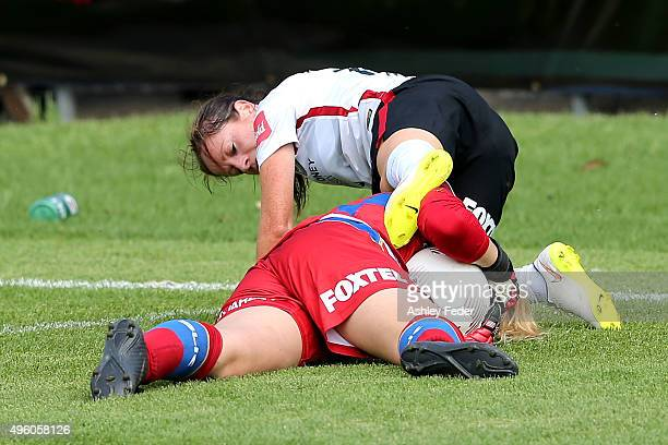 Michelle Carney of the Wanderers clashes with Hanna Southwell goalkeeper of the Jets during the round four WLeague match between the Newcastle Jets...