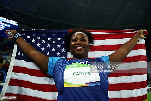 Michelle Carter of the United States celebrates placing first in the Women's Shot Put Final on Day 7 of the Rio 2016 Olympic Games at the Olympic...