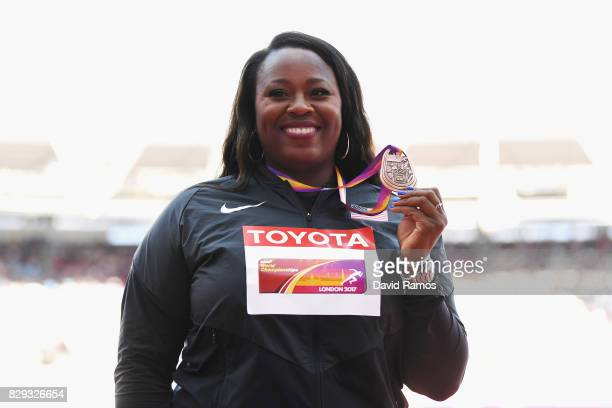 Michelle Carter of the United States collects her bronze medal following the womens shot put final during day seven of the 16th IAAF World Athletics...