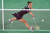 Michelle Chan of New Zealand plays a backhand as she competes in her women's singles badminton quarterfinal match at Emirates Arena during day nine...