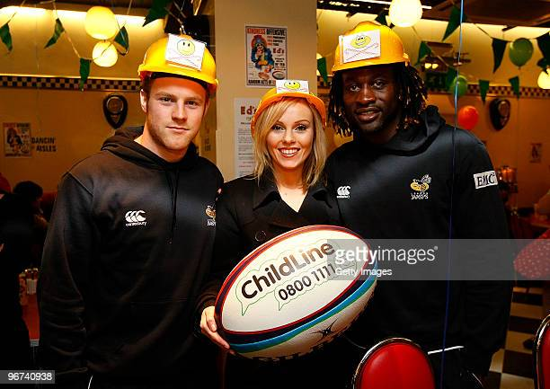Michelle Dewberry together with Joe Simpson and Paul Sackey of London Wasps pose for photos during a photo call to promote the ChildLine Guinness...