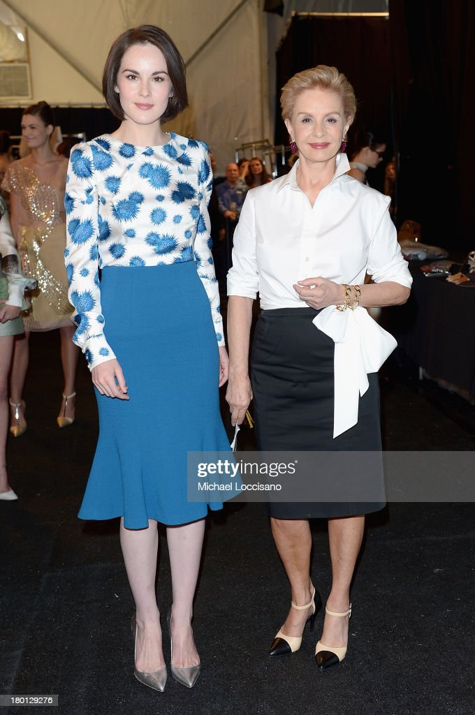 Michelle Dockery (L) and Carolina Herrera pose backstage at the Carolina Herrera fashion show during Mercedes-Benz Fashion Week Spring 2014 at The Theatre at Lincoln Center on September 9, 2013 in New York City.