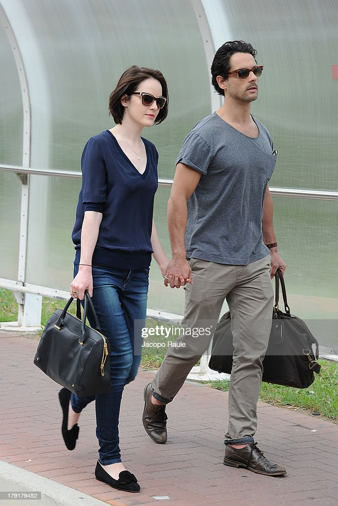 Michelle Dockery and her boyfriend are seen leaving the Venice Airport during The 70th Venice International Film Festival on September 1, 2013 in Venice, Italy.