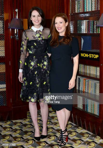 Michelle Dockery and Julianne Moore attend a photocall for the film 'Non Stop' at The Dorchester on January 30 2014 in London England