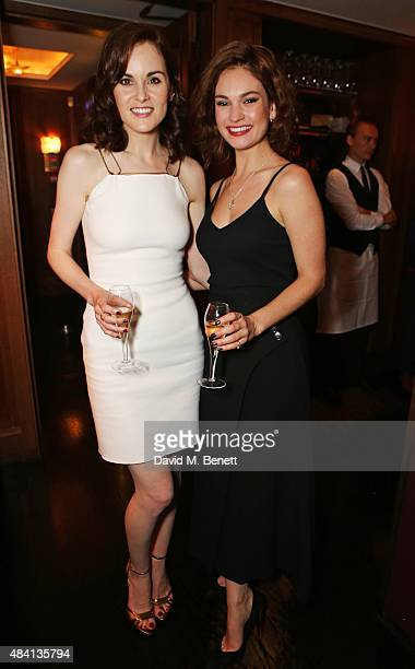 Michelle Dockery and Lily James attend the Downton Abbey wrap party at The Ivy on August 15 2015 in London England