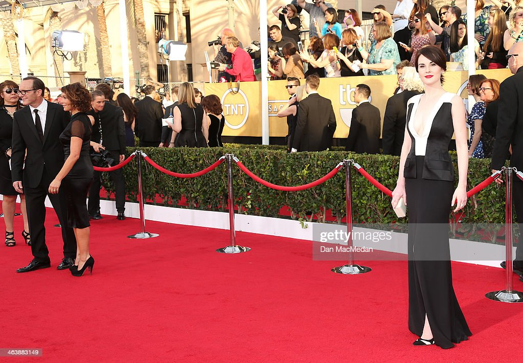 Michelle Dockery arrives at the 20th Annual Screen Actors Guild Awards at the Shrine Auditorium on January 18, 2014 in Los Angeles, California.