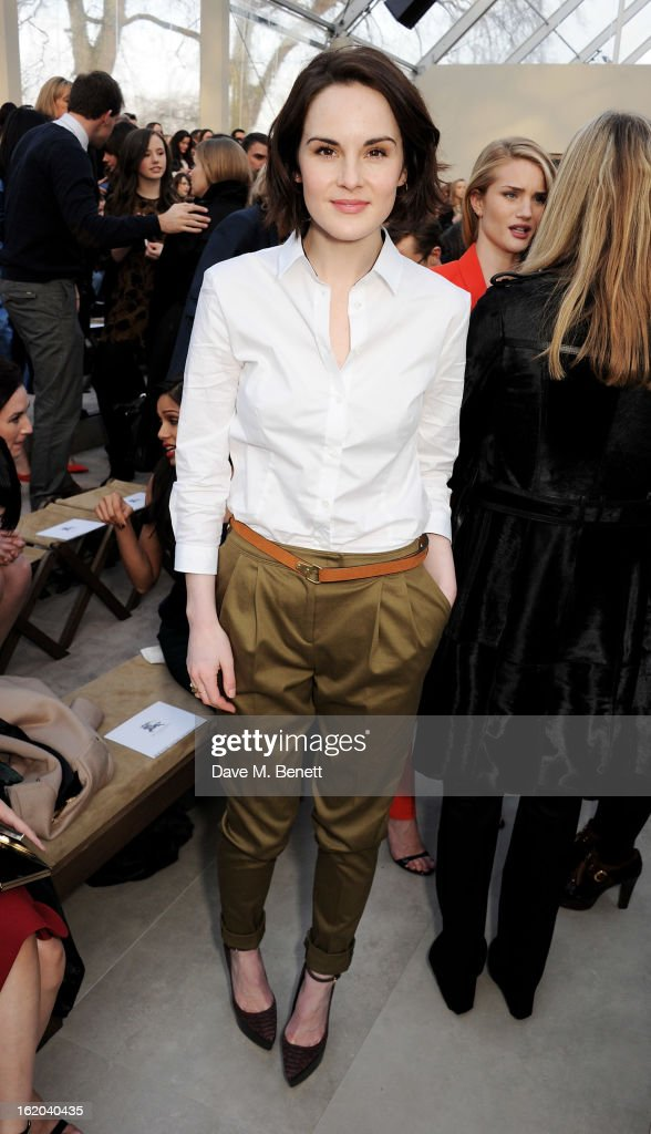 Michelle Dockery arrives at the Burberry Prorsum Autumn Winter 2013 Womenswear Show at Kensington Gardens on February 18, 2013 in London, England.