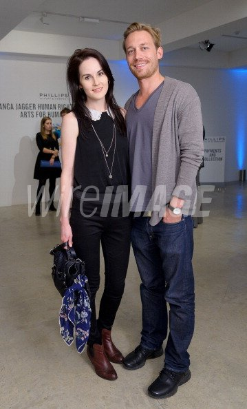 Michelle Dockery attend charity auction...