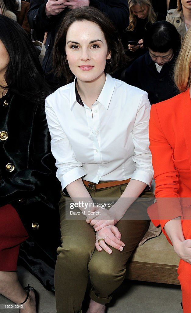 Michelle Dockery sits in the front row for the Burberry Prorsum Autumn Winter 2013 Womenswear Show at Kensington Gardens on February 18, 2013 in London, England.