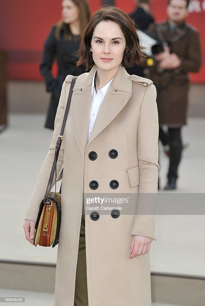 Michelle Dockery wearing Burberry, arrives at the Burberry Prorsum Autumn Winter 2013 Womenswear Show on February 18, 2013 in London, England.