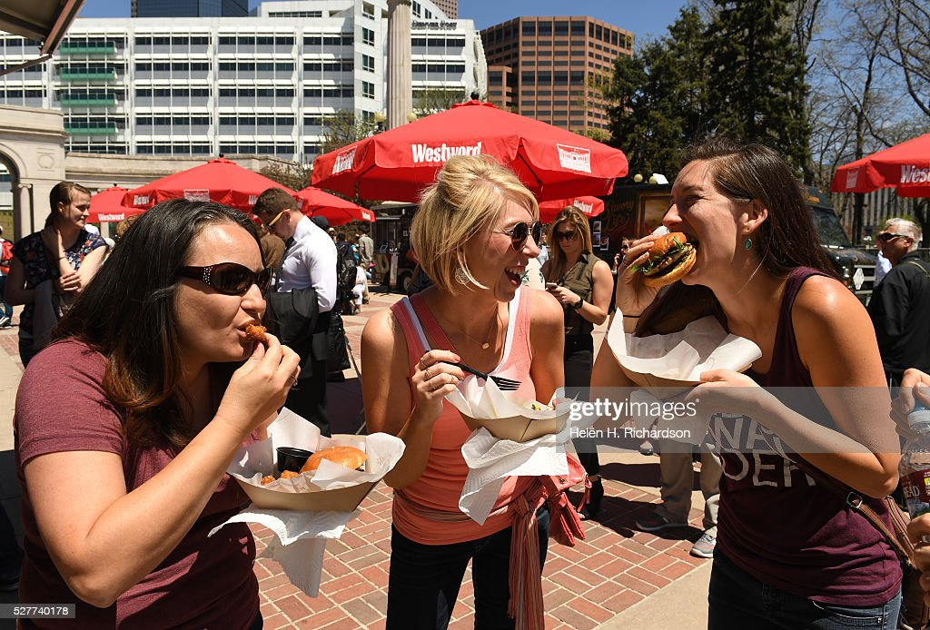 Michelle Duvall, left, Jennifer Hooten, middle and Amy McCullough, right, enjoy delicious food from a variety of food trucks at Civic Center Park on the first day of the 11th annual Civic Center EATS on May 3, 2016 in Denver, Colorado. This is metro Denver's largest gathering of gourmet food trucks and carts and is a showcase of Denver's culinary and entrepreneurial diversity. The daily lunch event runs through October 6th from 11 am to 2 pm Tuesdays, Wednesdays and Thursdays.
