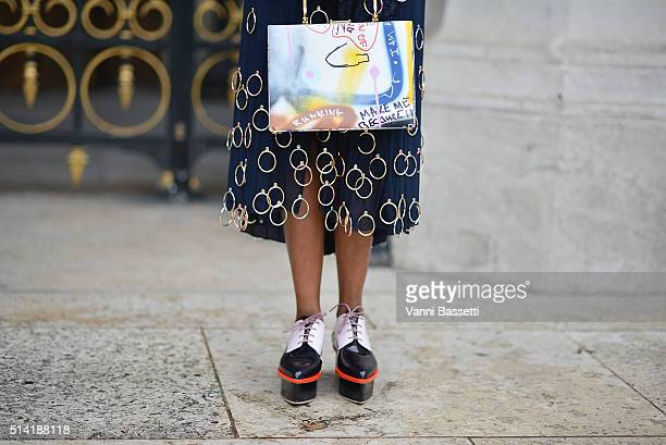 Michelle Elie poses wearing an Esteban Cortazar dress and Prim by Michelle Elie bag before the Stella McCartney show at the Opera Garnier during...