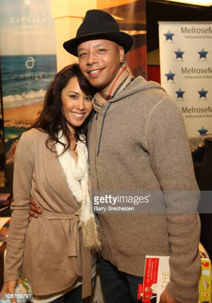 Michelle Ghent and actor Terrence Howard pose at the Kari Feinstein Style Lounge on January 21 2011 in Park City Utah