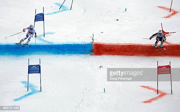 Michelle Gisin of Switzerland races Sofija Novoselic of Croatia during the Nations Team Event at Golden Peak Stadium on Day 9 of the 2015 FIS Alpine...