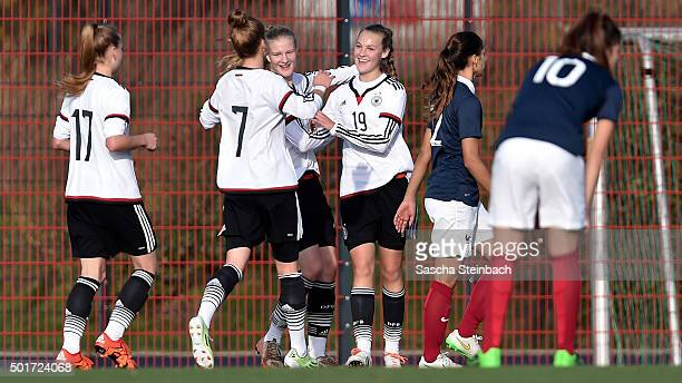 Michelle Herrmann of Germany celebrates with team mates after scoring the opening goal during the U17 girl's international friendly match between...